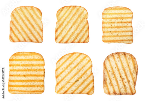 Fotografie, Obraz Set with toasted slices of wheat bread on white background, top view