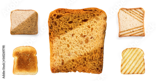 Obraz na plátně Set with toasted slices of wheat bread on white background, top view
