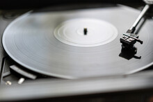 A Black Vinyl Record Is Spinni...