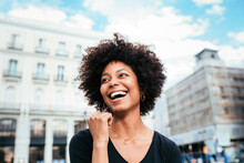 Afro Young Woman Laughing Whil...