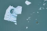 Aerial view of canoes and iceberg in lagoon, Lake Palmer, Anchorage, Alaska, USA