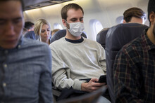 Male Passenger With Flu Mask U...