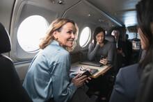 Smiling Businesswomen Talking ...