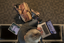 Woman With Laptop Working In A...