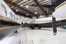 Private Jets In Airplane Hangar