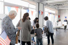 Volunteer Helping Voters Check...