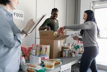Female Volunteers Sorting Food...