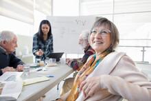 Smiling Senior Woman Learning ...