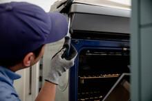 Man Repairing Oven