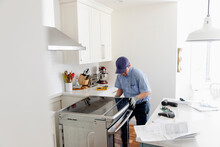 Man Installing Oven At Home