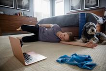 Woman Exercising In Bedroom Wa...