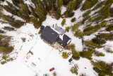 Drone shot over house in snow