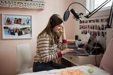 Teenage Girl Recording Music A...