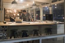 Designer Working In Office At Night