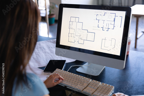 Asian architect woman working on computer