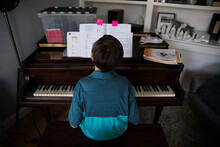 Rear View Of Tween Boy Playing...