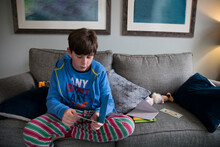 Teen Boy In Striped Pajamas Re...