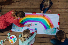 Children Painting An Uplifting Sign For Covid-19 Quarantine