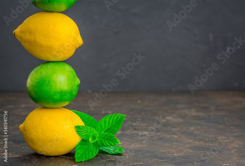 lime and lemon  on a black background