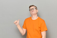Portrait Of Funny Proud Mature Man Pointing With Thumb At Himself