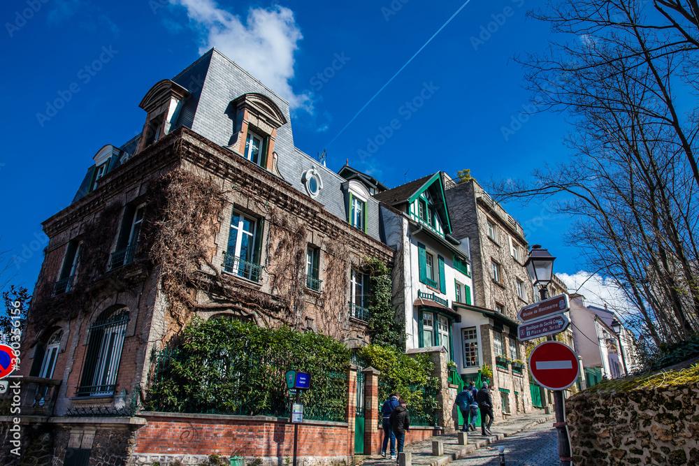 Fototapeta Corner on the steep streets of the famous Montmartre neighborhood in Paris