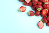 Tasty ripe strawberries on light blue background, flat lay. Space for text