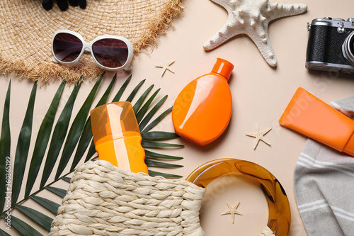 Fototapeta Flat lay composition with sun protection products and beach accessories on beige background obraz