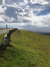 Guard Rail Along The Green Meadows On The Slopes Of Haleakala