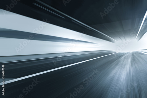 motion blurred asphalt road in tunnel with copy space. Wallpaper Mural
