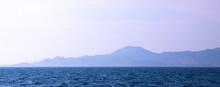 Silhouette Of A Rocky Island I...