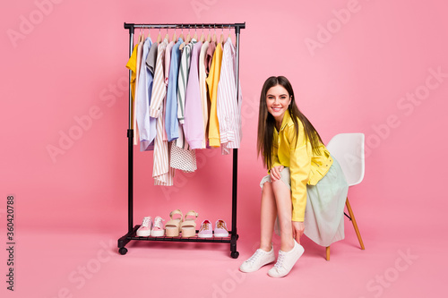 Full length photo of pretty lady showroom fashion collection choosing clothes pu Fotobehang