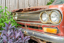 Datsun 1300 Headlight, Red Color, The Car Code Number 620, Produced In Early 1972 In Japan Have Been Imported For Sale In Thailand, Rusted And Retro Look With Nature