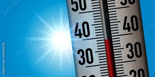 Fotomural Concept de la canicule avec un thermomètre pris en gros plan pour montrer la hausse des températures suite au réchauffement climatique