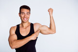 Close-up portrait of his he nice attractive sportive successful muscular cheerful cheery glad guy demonstrating powerful muscles result effect goal isolated over light gray pastel color background