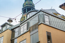 Close-up Of Modern Exterior Of Building In Old Town Of Riga, Latvia. Windows And Metal Loof. Tower Of St. Peter's Church.