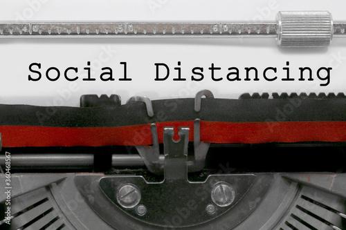 Social Distancing text on white sheet in vintage typewriter Wallpaper Mural