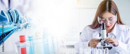 Cuadros en Lienzo Asian scientist woman lab technical service observe liquid sample with lab glass