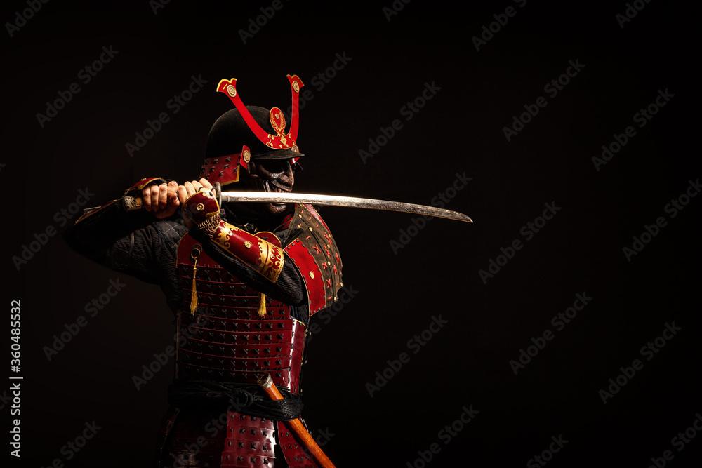 Fototapeta Portrait of a samurai in armor in attack position