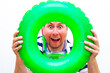 canvas print picture - Diver gesturing palm inflatable ring green trendy colors snorkel goggles showing swimming gesture with hands over white