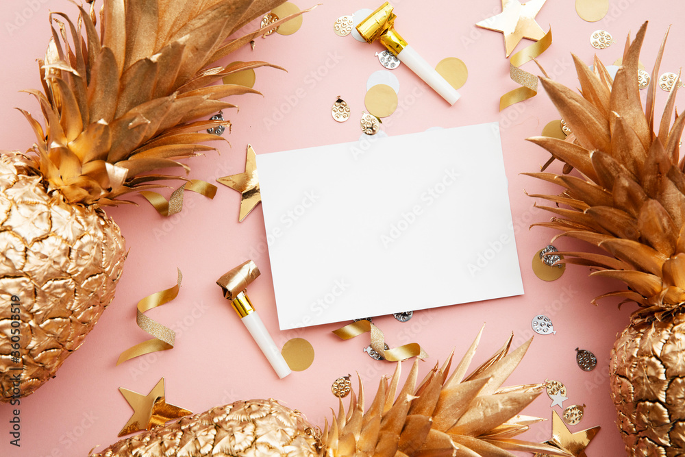 Fototapeta Flat lay tropical pineapple and confetti party celebration background