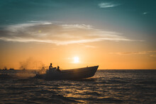 Boat Sunset Over The Sea