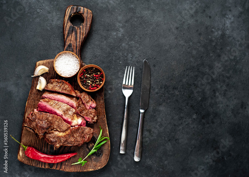 Grilled beef steak with spices on a stone background with copy space for your text Canvas Print