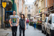 A couple in love slowly walks the streets of the city on a cool autumn morning.