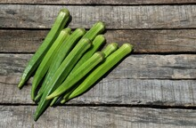 Raw Lady Finger Or Okra Vegetable Isolated On Wooden Background With Copy Space For Texts Writing