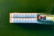 Overhead View Of A Shipping Barge Moving Through The Intercoastal Waterway