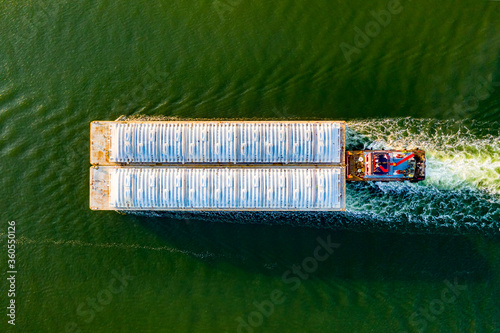 Overhead view of a shipping barge moving through the intercoastal waterway Canvas