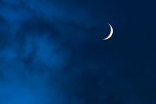 Blue Foggy Sky With Crescent O...