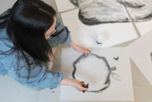 Artist Drawing With Charcoal I...
