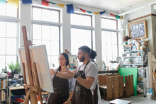 Artists At Easel In Art Studio