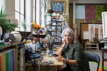 Mature Woman Sitting At Desk I...